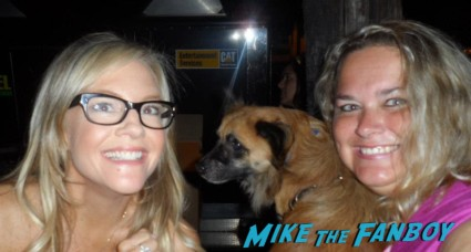 rachael harris  posing for a photo with pinky from mike the fanboy at an emmy party in beverly hills