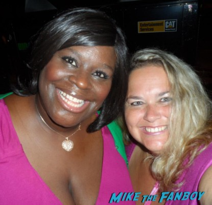 retta posing for a photo with pinky from mike the fanboy at an emmy party in beverly hills