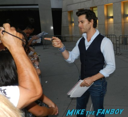 hot and sexy random actor signing autographs for fans at the words movie premiere with bradley cooper and zoe saldana