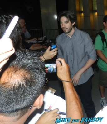director jason reitman signing autographs for fans at the words movie premiere with bradley cooper and zoe saldana