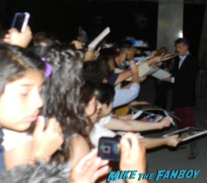 jeremy irons from the borgias signing autographs for fans at the words movie premiere with bradley cooper and zoe saldana