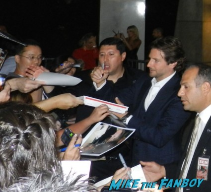 sexy hot bradley cooper signing autographs for fans at the words movie premiere with bradley cooper and zoe saldana
