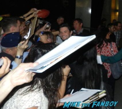 dennis quaid ben barnes signing autographs for fans at the words movie premiere with bradley cooper and zoe saldana