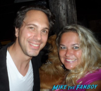 thomas sadoski posing for a photo with pinky from mike the fanboy at an emmy party in beverly hills