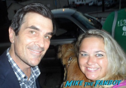 ty burrell posing for a photo with pinky from mike the fanboy at an emmy party in beverly hills