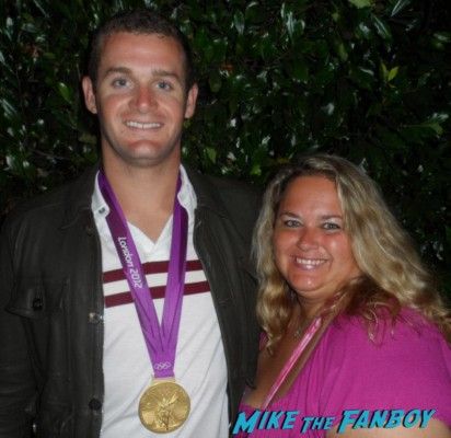 tyler clary  posing for a photo with pinky from mike the fanboy at an emmy party in beverly hills