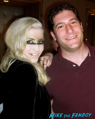 Ke$ha posing for a fan photo with mike the fanboy at her concert at the el rey theater in los angeles rare promo