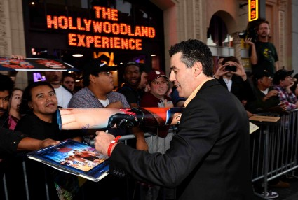 "adam carolla signs autographs for fans at the Premiere Of Walt Disney Animation Studios' ""Wreck-It Ralph"" - Red Carpet"
