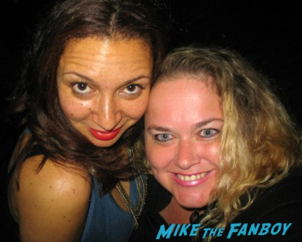 Maya Rudolph signing autographs for fans photo opp rare promo pinky from mike the fanboy taking a fan photo with Maya Rudolph