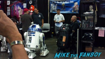 """star wars r2d2 robert at comikaze 2012 stan lee's rare promo God bless The Novel Strumpet.  She's a tad more lenient than perhaps I... Then again I did read her Elementary review!  LOL... The Novel Strumpet made her way down to Comikaze last month, and has done a little write up on the experience.   I sat this one out, as I was told that """"Comikaze would only welcome large media outlets"""" Still burned by that one.  Sorry.  Anyway, I'm not going to pour my bile all over the net!    Check out The Novel Strumpet's recap after the jump!  __________________________________________________________________________________   Stan Lee's Comikaze Expo 2012:  What a difference a year makes.  Last year we got there, went into a basement parking lot, tried to fight our way through really crowded in booths and panels were held in """"tents"""" (ok fabric over poles in a square format but still).  This year they were on an actual floor in the convention center, there was quite a bit of space between booths and they actually had rooms for panels.  Fancy shmancy!  I've read Susan aka Suddenly Susan's take and I get it.  I mean let's face it I attend things for books and while there were comics for sale (I'd tried to look for a copy of Lady Mechanika at their booth but every time I walked over…nothing…how is that possible?) and a panel about books – which I missed due to said line fiasco in Susan's report – I knew there wouldn't be much.  But I wanted to see how the show had changed, and I like exploring the booths because I might discover something new.    I went with some work colleagues, one of whom went dressed as Captain Jack Harkness, and boy did she pick the perfect year to do that!  I spent quite a bit of time in front of the Tardis booth and stopping to watch her get mobbed by Doctor's everywhere.  They were stalking her I swear, probably because she was the only Capt. Jack in a sea of Docs and Companions.  Lots of fun, though.    Pic Cap'n and Tardis Captain Jack holding on while t"""