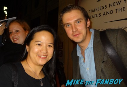 dan stevens from Downton abbey posing with erica from Mike The Fanboy Downton abbey star dan stevens signing autographs for fans after a performance of heiress on Broadway