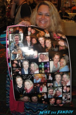 Pinky holding her poster with all 900 photos she has with Sam Trammell on them signed autograph by the true blood star