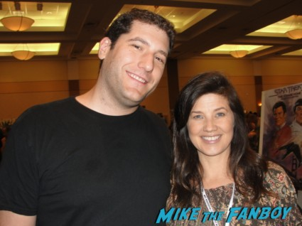 Daphne Zuniga posing for a fan photo with mike the fanboy at the hollywood collector's show in burbank signed autograph spaceballs star now melrose place