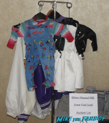 original chucky costumes from child's play on display at horror.com auctions