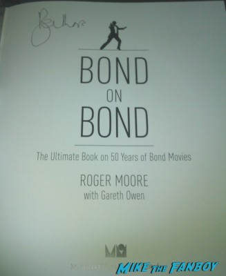 roger moore signed autograph signature rare promo bond on bond book signing Roger Moore signing autographs for fans at his bond on bond book signing at harrod's in london rare signature promo
