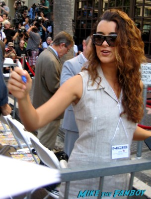 Cote de Pablo signing autographs at Mark Harmon's walk of fame star ceremony in hollywood
