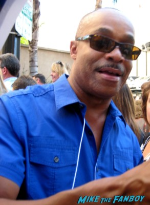 Rocky Carroll signing autographs for fans at mark harmons walk of fame star ceremony in hollywood hocus pocus star