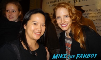 Jessica Chastain posing for a fan photo with mike the fanboy's erica signing autographs for fans rare promo