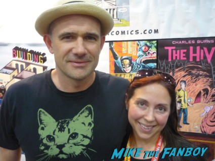 the novel strumpet and author Mark Z Danielewski posing for a fan photo at san diego comic con after their interview