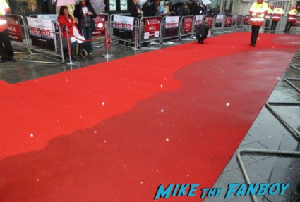 the red carpet soaking up rain BFI London Film Festival rare blood movie premiere rare paul bettany signing autographs for fans rare