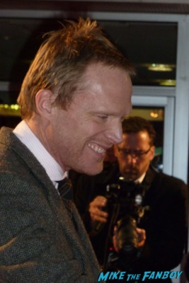 paul Bettany signing autographs for fans at the red carpet soaking up rain BFI London Film Festival rare blood movie premiere rare paul bettany signing autographs for fans rare