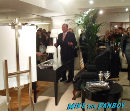 Roger Moore signing autographs for fans at his bond on bond book signing at harrod's in london rare signature promo