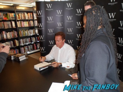 Arnold Schwarzenegger signing autographs for fans at his book signing for  Total Recall: My Unbelievably True Life Story