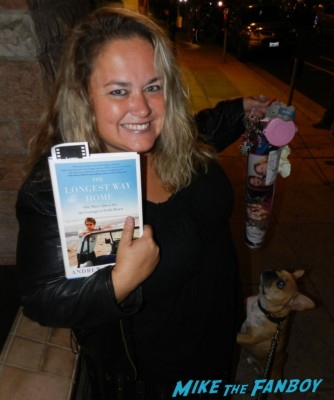 pinky reading her andrew mccarthy book the long way home at theo the adorable french bulldog brown rare biting pinky lovejoy's hello kitty keychain pinky lovejoy posing with her dog sammy rhodes at andrew mccarthy's book signing at the aero theater