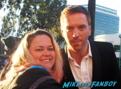 Damian Lewis poses for a fan photo with pink from mike the fanboy at a homeland fan event