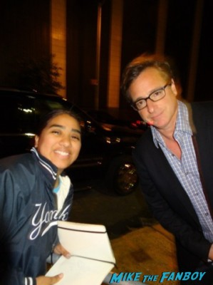 Bob Saget signing autographs and posing with elisa from mike the fanboy at the night of too many stars in new york city