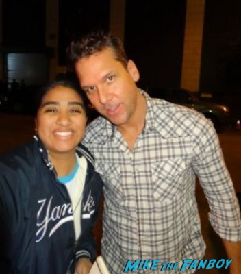 Dane Cook signing autographs and posing with elisa from mike the fanboy at the night of too many stars in new york city