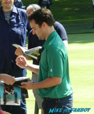 jake johnson from new girl signing autographs for fans at the los angeles police golf tournament signed photo poster rare promo