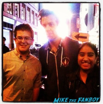 jason sedakis from SNL  posing for a fan photo with elisa from the big apple from mike the fanboy in new york rare promo