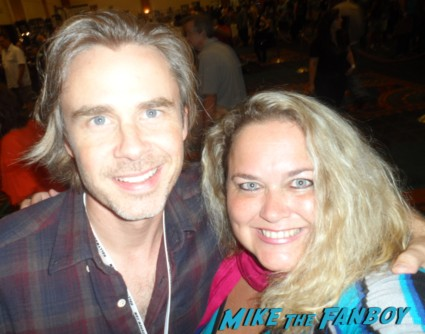 pinky taking a photo with true blood star sam trammell at the hollywood show autograph photo and more