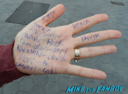 a fan girl writing notes on her hand for the cast of the walking dead season 2 premiere red carpet at universal studios citywalk rare signing autographs hot sexy promo amc