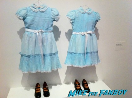 The shining twins rare dresses costumes on display photo from the LACMA Stanely Kubrick exhibit prop costumes rare promo script posters