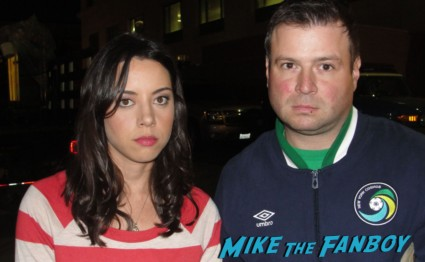 aubrey plaza from parks and recreation posing with billy beer for a fan photo on the set of parks and recreation rare promo