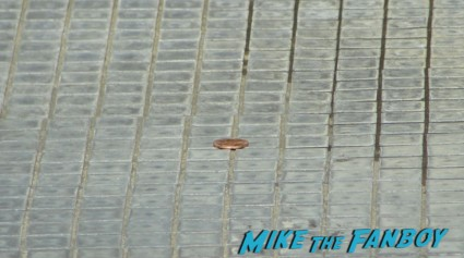 the sad penny that did not make it into the fountain while waiting for the happy endings cast