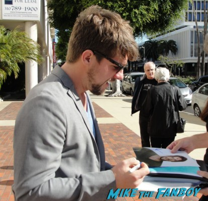 Zachary Knighton signing autographs for fans at the happy endings q and a in los angeles