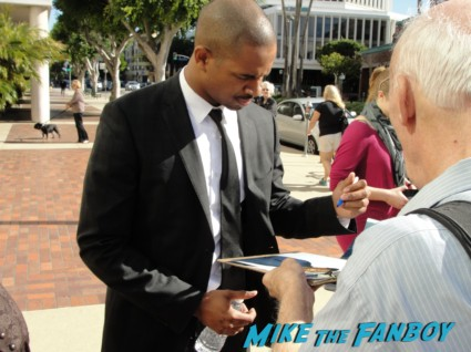 Damon Wayans Jr. signing autographs for fans at a happy endings q and a in los angeles