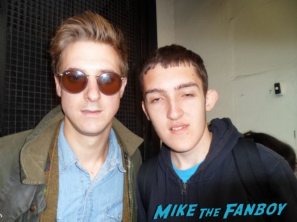 Arthur Darvill posing for a fan photo with daniel signed autograph photo rare dr. who promo Arthur Darvill signing autographs for fans