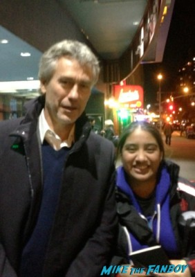 Tony Gilroy director of bourne legacy poses for a fan photo with elisa in the big apple from mike the fanboy