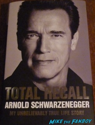 Arnold Schwarzenegger signed autograph signature total recall my life so far signing autographs at his book signing at waterstons in london the uk rare promo book signing