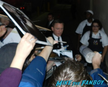 daniel craig signing autographs for fans 007 daniel craig signed autograph the girl with the dragon tattoo signature skyfall mini poster daniel craig signing autographs for fans daniel craig signing autographs for fans arriving to the jimmy kimmel live television show hot sexy james bond 007 skyfall star rare promo