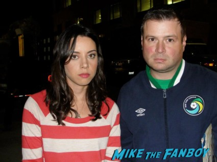 aubrey plaza signing autographs for fans at the total recall movie premiere rare