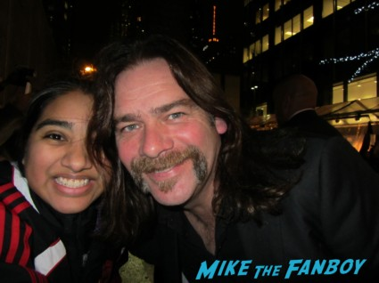 Alan Doyle posing for a fan photo with elisa in the big apple Amanda Seyfried signing autographs for fans at the les miserables premiere in new york city rare promo signed