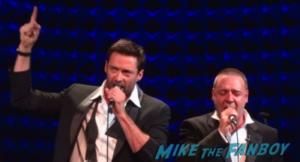 sexy hugh jackman and  Russell crowe singing onstage at russell crowe's garden party concert in new york city live onstage