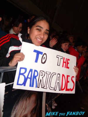 Elisa in the big apple holding a sign for the celebrities at the les miserables movie premiere in new york city