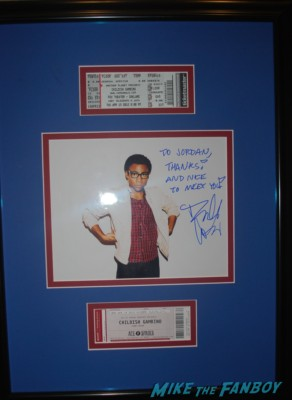 Community cast signed autograph cast photo with Joel Mchale ken jeong chevy chase Childish Gambino concert aka: Donald Glover signing autographs for fans rare promo signed photo concert marquee oakland ca marquee hot community star rare promo