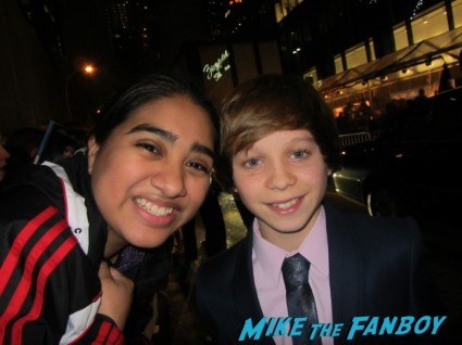 Daniel Huttlestone fan photo while signing autographs for fans at the les miserables movie premiere in new york city signed autograph rare